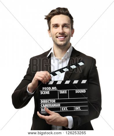 Young man in a suit holding a movie clapperboard, on white background