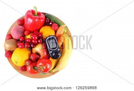 Glucose meter with fresh ripe fruits and vegetables lying on wooden plate copy space for text concept of diabetes healthy food nutrition and strengthening immunity. White background
