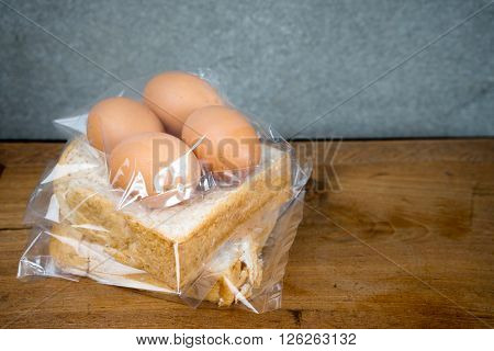 Bread And Egg In Plastic Bag