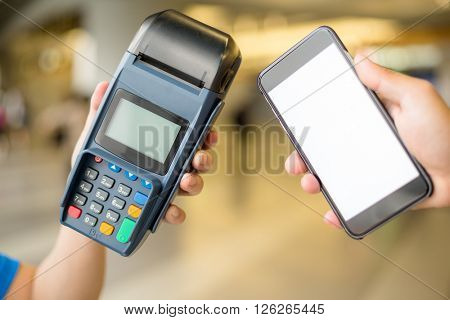 Woman pay with cellphone by NFC technology
