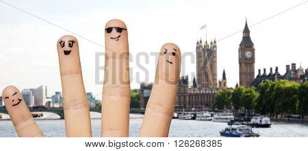travel, tourism, family, people and body parts concept - close up of four fingers with smiley faces over london city background