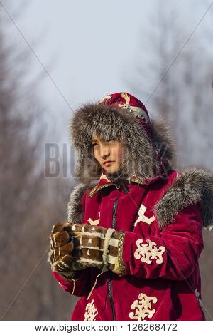 Iengra Neryungri District Yakutia Russia. February 15 2015 young Evenk in national costume