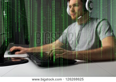 technology, gaming, entertainment, let's play and people concept - close up of young man in headset with pc computer playing game at home and streaming playthrough or walkthrough video