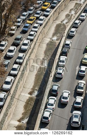 Tehran, Iran - November 30, 2015: Cars parked on street of Tehran, Iran.