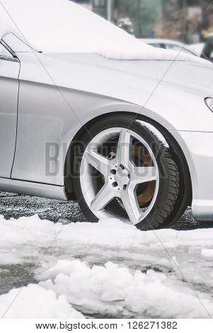 Modern Car Wheel On The Snowy Ground