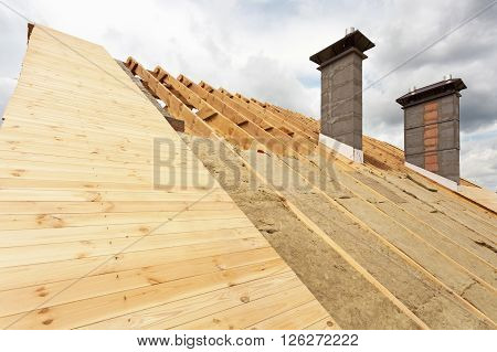 Roof under construction. Installation mineral wool insulation