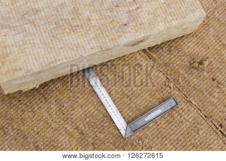 Mineral rockwool panels with metallic ruler close up