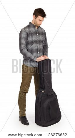 Musican With Acoustic Guitar In Bag