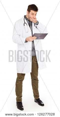 Male Caucasian Doctor Holding A Digital Tablet, Looking Shocked