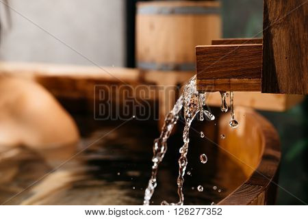 Onsen series : Blurry background of woman in wooden bathtub