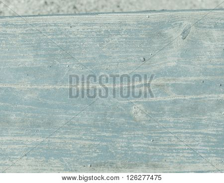 Old painted wood background. Close up of vintage wood with cracked paint.