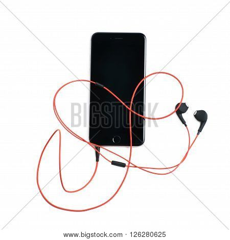 Red headphones in a smart phone, composition isolated over the white background