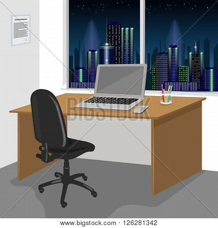 Wide view of a work desk interior with a laptop computer and window with night city scenery