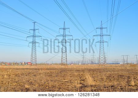 Power line in the countryside in the early spring on the outskirts of St. Petersburg Russia.