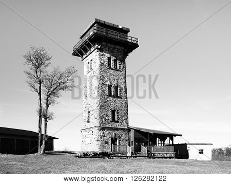 Kurz's tower, tourist lookout tower on the summit of Cerchov Mountain, Czech Republic. Black and white image.