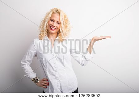 Happy and funny  woman with extended hand sign