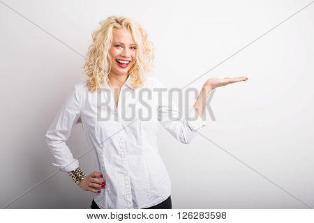 Happy woman smiling and  holding her hand extended