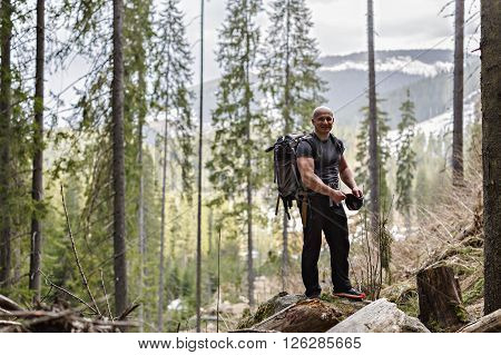 Professional Nature Photographer Working In A Forest