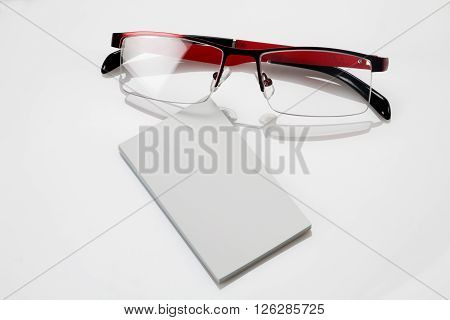 Blank business card with eyeglasses for mockup