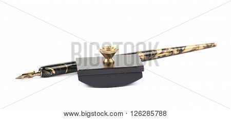 Dip nib ink pen with a blotting paper press, composition isolated over the white background