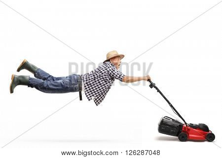 Mature gardener being pulled by a powerful lawn-mower isolated on white background