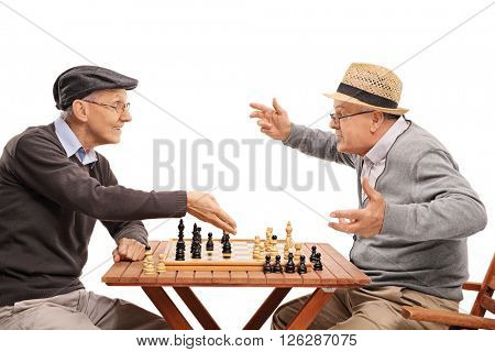 Two old people playing a game of chess isolated on white background
