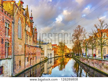 View From Steenhouwersdijk Street To Typical Brick Houses Along Canal,  Bruges, Belgium
