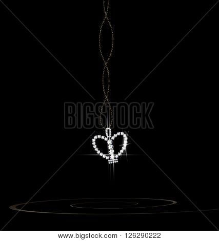 dark background and the jewelry chains and pendant crown