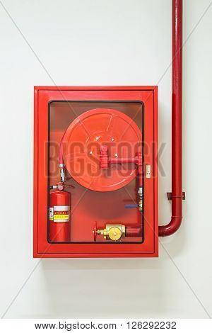 Wall mounted fire hose and extinguisher cabinet and water plumbing