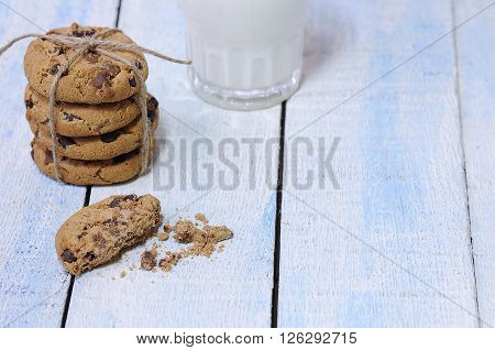Close-up Of Glass Of Milk And Stack Of Cookies