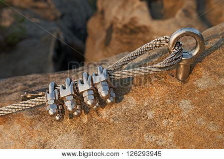 Solid Knot On Steel Rope. Iron Twisted Rope Fixed In Block By Screws Snap Hooks. Detail Of Rope End
