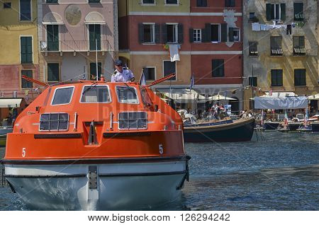 Portofino Italy - May 29 2015: helmsman arrives with the ship for the transport of passengers.