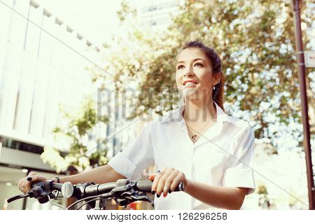 Portrait of happy young female bicyclist