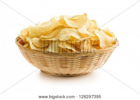 Crispy potato chips in a wicker bowl on white background