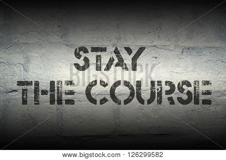 stay the course stencil print on the grunge white brick wall
