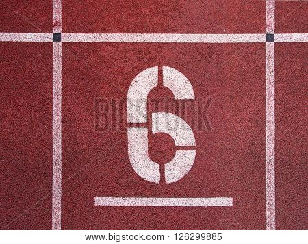 Number Six. White Track Number On Red Rubber Racetrack, Texture Of Running Racetracks In Athletic St