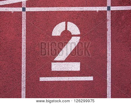 Number Two. Big White Track Number On Red Rubber Racetrack. Gentle Textured Running Racetracks In Sm