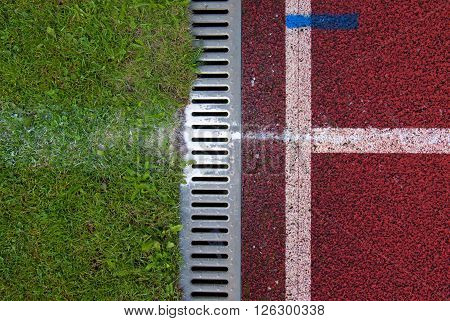 Channel At Red Running Racetrack On The Athletic Stadium. Drain