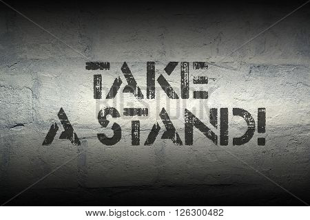 take a stand exclamation stencil print on the grunge white brick wall