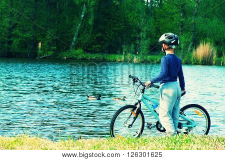 Small Boy, Bikerider In Sport Helmet  On The Beach.