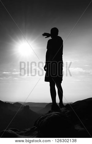 Hiker Stand On The Sharp Corner Of Sandstone Rock In Rock Empires Park And Watching  To Sun