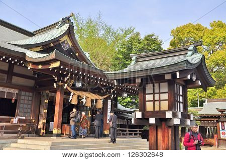 KUMAMOTO, JAPAN - APRIL 7, 2014: Unidentified people praying at Izumi shrine in Suizenji Jojuen garden at Kumamoto Prefecture, Kyushu, Japan. Izumi shrine was established in 1878.