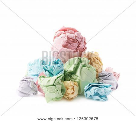 Pile of multiple colorful crumpled paper balls isolated over the white background