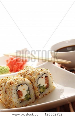 Close-up of sushi on a plate, soy sauce.