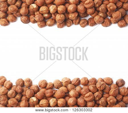 Copyspace background composition with the borders made of hazelnuts isolated over the white background