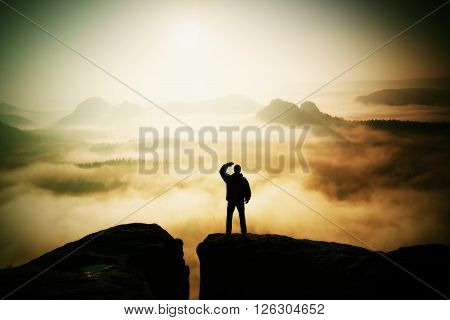Beautiful Moment The Miracle Of Nature. Man Stands On The Peak Of Sandstone Rock In National Park Sa
