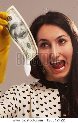 frightened woman launder shady money (illegal cash dollars bill corruption manipulation)