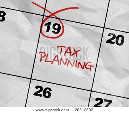 Concept image of a Calendar with the text: Tax Planning