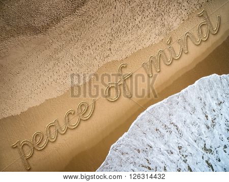 Peace of Mind written on the beach