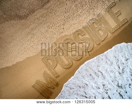 Im-Possible written on the beach